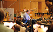 Conductor Pete Anthony gives feedback to the orchestra