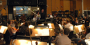 Director Peggy Holmes and composer Jim Dooley talk to the orchestra