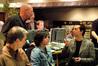 Composer Jim Dooley talks with Disney exec Brett Swain while Matt Walker and Peggy Holmes listen
