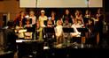 Blake Neely conducts the female choir