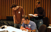 Scoring intern Aaron Moore, composer Christopher Lennertz and orchestrator Andrew Kinney