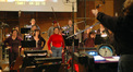 Pete Anthony conducts the choir on <i>Semi-Pro</i>