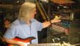 George Doering configures his guitar