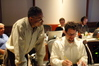 Orchestra contractor Reggie Wilson and Michael Giacchino examine a cue