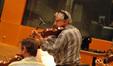 Concertmaster Endre Granat tunes up