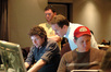 Matthew Margeson watches as Nick Wollage, Christian Davis and Kevin Globerman work on ProTools