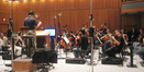Jason Poss conducts the <i>Assassin's Creed II</i> string section