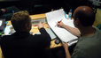 John Ottman and orchestrator Rick Giovinazzo check the schedule for the next day