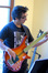 John Avila plays bass guitar