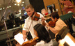 Concertmaster Bruce Dukov gives the orchestra an A for tuning