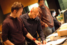 Composer Brian Tyler talks with music editors Joe Lisanti and Gary Krause