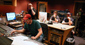 Austin Wintory chats with the engineer Lewis Jones and contractor Isobel Griffiths over the ISDN. ProTools operator Kevin Globerman monitors the Abbey Road feed along with assistant ______, while sound designer Brett Hinton and writer/director Paul Solet listen.