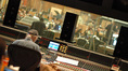 Scoring mixer Dan Wallin works as the orchestra performs