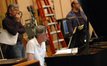 Music librarian Mark Graham watches as Alan Silvestri reworks a cue