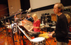 Bob Leatherbarrow, Marie Matson, Mike Englander and MB Gordy play percussion