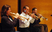 Marissa Benedict, Chris Tedesco and Tim Divers play trumpet