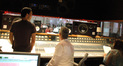 Composer Steve Jablonsky, scoring mixer Jeff Biggers and orchestrator Penka Kouneva watch the orchestra