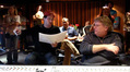 Composer Austin Wintory (left) and engineer Steve Kempster (right) reviewing a cue