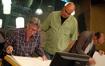 Composer Alan Silvestri and score coordinator Dave Bifano examine a cue