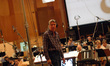 Composer Alan Silvestri looks to the booth for feedback on a cue