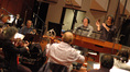 Jeff Atmajian talks with the orchestra as Marc Shaiman watches