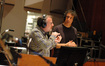 Composer Marc Shaiman talks to the orchestra as Jeff Atmajian observes