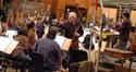 Concertmaster Endre Granat talks to the violins