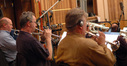 Rob Frear, Jon Lewis and David Washburn play trumpet