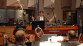 Tim Davies conducts the orchestra