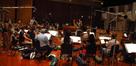 The orchestra performing on <i>No Ordinary Family</i>