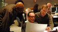 Music librarians Booker White and Marshall Bowen discuss a cue with orchestrator David Slonaker