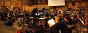 John Debney conducts the orchestra at Sony