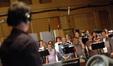 Brian Tyler conducts the choir
