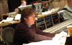 Orchestrator John Ashton Thomas reviews a cue