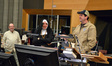 Michael Giacchino (in Lost costume) talks to the musicians as conductor Tim Simonec (in nun costume) looks on