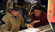 Composer Michael Giacchino and director Brad Bird examine a cue