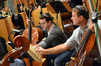 Actor Dermot Mulroney lends his talents to the cello section