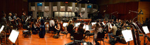The orchestra and composer and conductor Fil Eisler record a cue