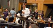 Contractor Reggie Wilson addresses the orchestra