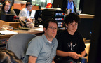 Michael Giacchino and his son listen to a cue