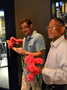 Michael Giacchino and contractor Reggie Wilson delight the ladies with Mother's Day carnations