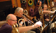 Alex Iles, Charlie Loper, Bill Reichenbach, and Phil Teele on trombones.