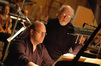 Arranger Randy Kerber and conductor John Wlliams go over the music