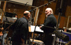 Arranger Randy Kerber talks with conductor John Williams