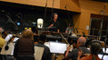 John Elg conducts the orchestra