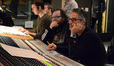 Additional music composers Marcus Trumpp and Brandon Roberts listen to a cue with director John Moore and composer Marco Beltrami