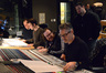 Orchestrator Jon Kull, additional music composer Brandon Roberts, director John Moore, and composer Marco Beltrami