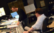 Composer Henry Jackman discusses a cue with scoring mixer Alan Meyerson