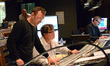 Composer Henry Jackman, scoring mixer Alan Meyerson, and stage recordist Tim Lauber work on a cue as music librarian Booker White looks on