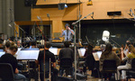 Composer Rob Simonsen conducts his score